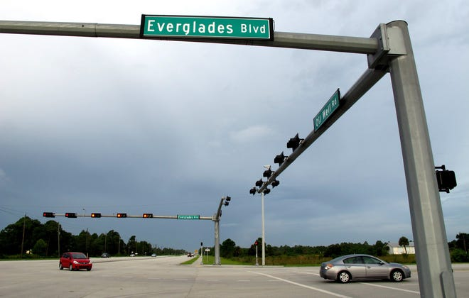FILE - The intersection of Everglades Boulevard and Oil Well Road.