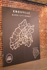 A large map from Native Maps provided a backdrop for photos during the Knoxville Maker City Summit Monday, Sept. 19, 2016, at the Mill and Mine, 227 W. Depot Avenue. Participants were encouraged to snap a selfie, as well as tweet, Snapchat, post on Instagram and Facebook or spread the word through any form of social media using the tag #Knoxmakersummit.