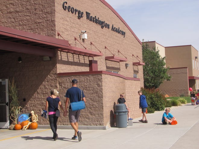 Families arrive at George Washington Academy in this undated file photo. The charter school is located in the Little Valley area of St. George.