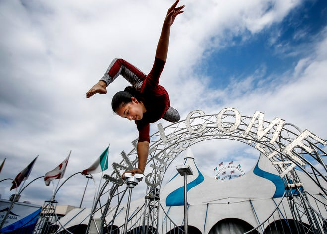 Contortionist Julliet Carballo, 15 and a sixth-generation circus performer, practices her routine while gearing up for the Cirque Italia-Water Circus event. European-style artists who have traveled the country since January will perform on a 35,000 gallon water stage under the big top this weekend.
