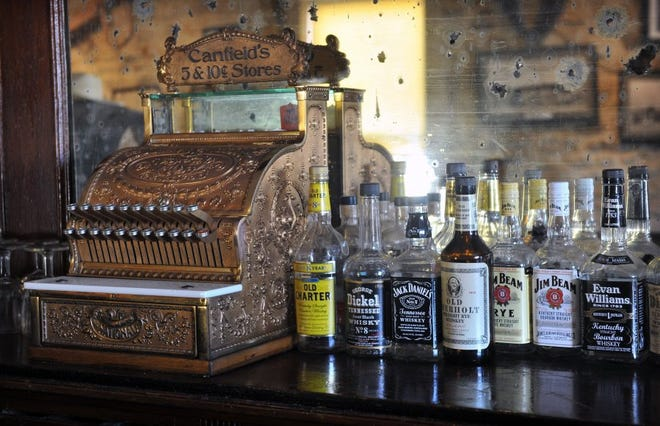 A vintage cash register and bottles of liquor at the Stonewall Saloon Museum in Saint Jo hearken back to its original role as a rest stop for settlers and cowboys on the Chisholm Trail. The museum features a wide variety of historical artifacts from the early days of Montague County.