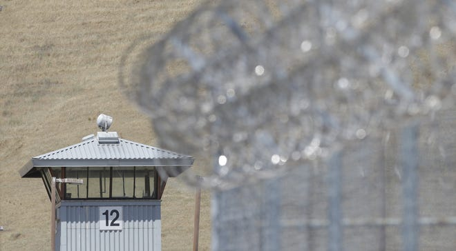 A guard tower and razor wire are seen at California State Prison Solano in Vacaville.