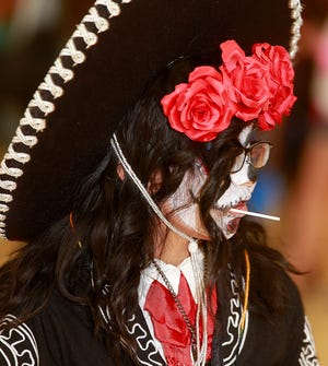 """Syuri Garcia, 10, shows off her mariachi costume during the San Juan College Halloween Carnival on Saturday, Oct. 29, 2016. San Juan College will hold a virtual """"Scare-O-Rama"""" Halloween costume contest in 2020. Registration begins at 12 p.m. Friday, Oct. 23, 2020."""