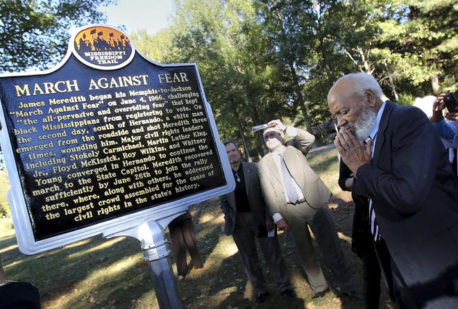 """In this Thursday, Nov. 10, 2016, photo, James Meredith pauses for a moment after unveiling a marker in Hernando, Miss., recognizing the spot where he was shot during the """"March Against Fear"""" from Memphis, Tenn., to Jackson, Miss., in 1966. Meredith, 32 at the time, was on the second day of the march when Aubrey James Norvell, an unemployed hardware salesman from Memphis, Tenn., stepped from a wooded area and peppered him across the chest with three shots from a 16-gauge shotgun."""