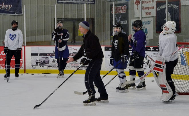 John Jay coach Alex Smith interrupts a drill to make a point on Monday during practice at Brewster Ice Arena.