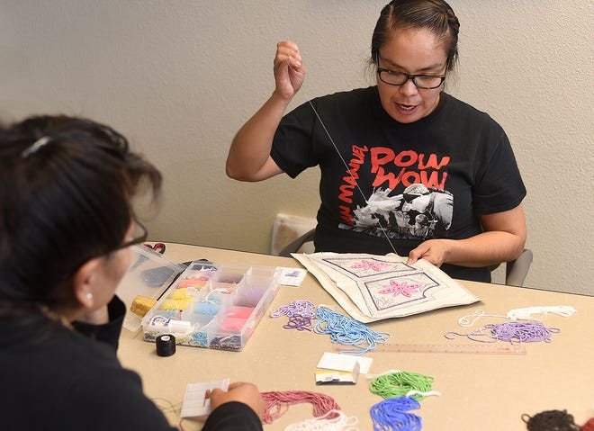 Verrona Cardinal, a sophomore psychology student at San Juan College, leads a beadwork workshop on Friday at the Native American Center at the college in Farmington.