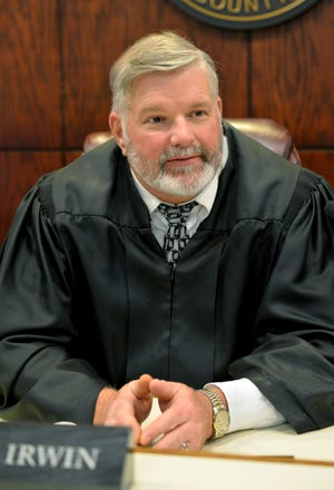 Knox County Juvenile Court Judge Tim Irwin presides over an increasing number of parental termination proceedings involving parents addicted to opioids.