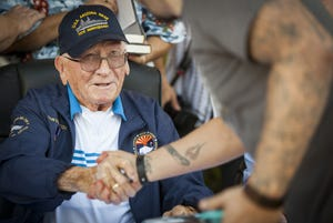 USS Arizona survivor Donald Stratton shakes hands with well-wishers during a meet and greet at the WWII Valor in the Pacific National Monument in Honolulu, Hawaii, on Dec. 6, 2016.