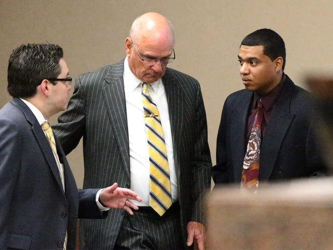 Devon Huerta-Person, right, talks with attorneys Omar Carmona, left, and Dolph Quijano before the start of his trial on Dec. 13, 2016, in 384th District Court.