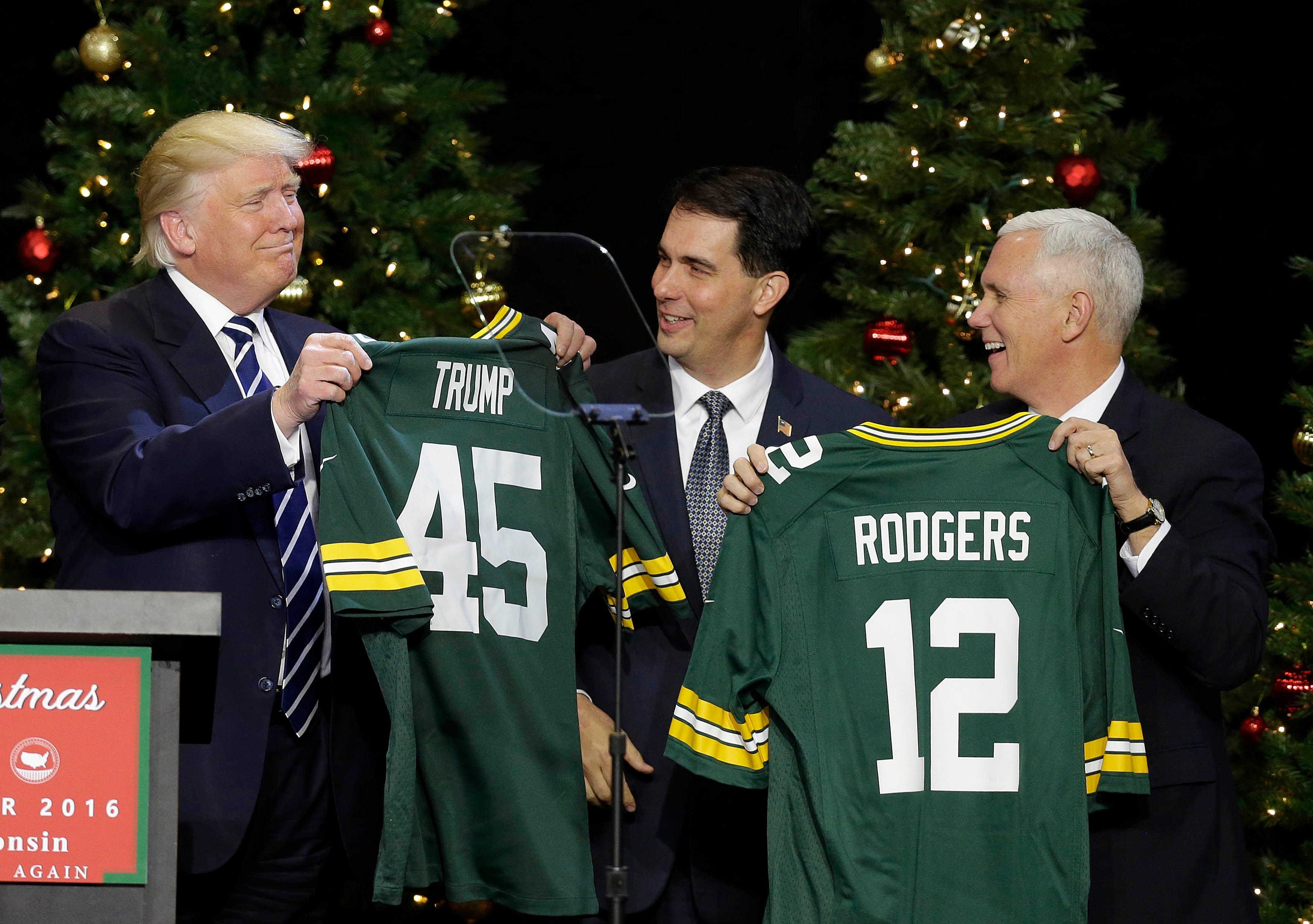 President-Elect Donald J. Trump  and Vice President-Elect Mike Pence, accept Packers jerseys from Governor Scott Walker and House Speaker Paul Ryan after Trump spoke  to supporters at the Wisconsin State Fair Exposition Center as part of the USA Thank You Tour 2016. Trump and Vice-President-Elect Mike Pence are touring states that helped him win the presidency in November.