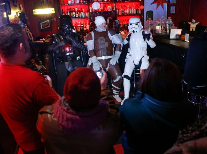 "Darth Vader, bounty hunter Dengar and a Stormtrooper attract cameras at Oddity Bar in Wilmington for a ""Star Wars""-themed bingo night Wednesday."