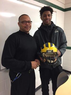 Detroit Cass Tech football coach Thomas Wilcher, left, with receiver Donovan Peoples-Jones on Dec. 16, 2016 at Cass Tech in Detroit.