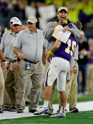 Wylie head coach Hugh Sandifer hugs quarterback Zach Smith (19) after a touchdown in the first quarter of Wylie's 31-17 loss in the Class 4A Div. I state championship game Dec. 16, 2016, at AT&T Stadium in Arlington. Sandifer coached Wylie to the 2004 state championship and four times in finals.