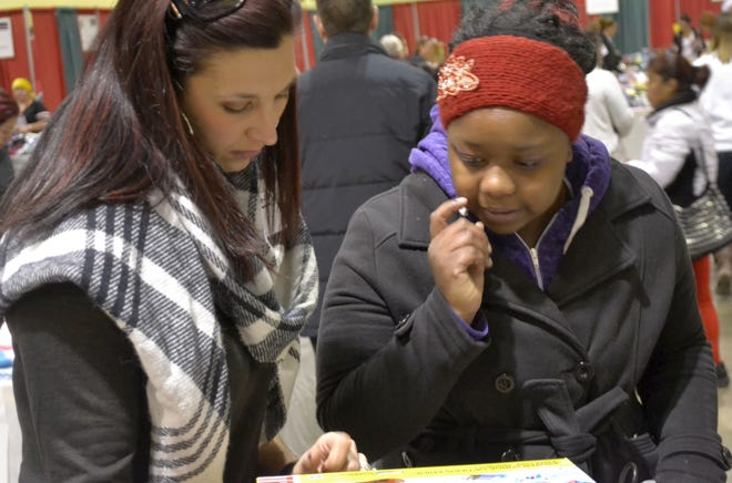 Volunteer shopper Melinda Morella-Olson, left, helps Renita Wilson of Green Bay pick out toys for her children during The Salvation Army of Greater Green Bay's annual Christmas Assistance Distribution at Shopko Hall in Ashwaubenon.