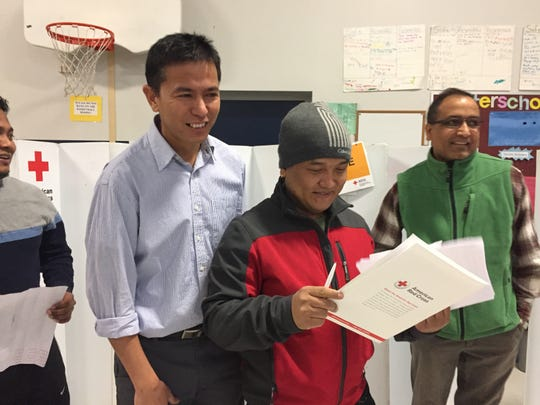 Hemant Ghising and Damber Gurung, center, with Prati Gurang, left, helped organized the blood drive on Sat. Dec. 24, 2016.