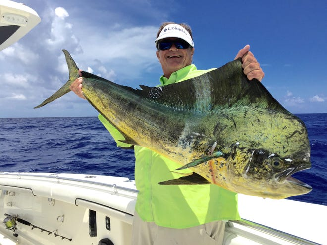 World class angler George Poveromo is pictured here with a big bull dolphin.