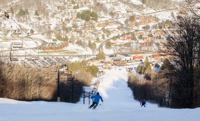 Skiers head down Iliad at Greek Peak Mountain Resort on Sunday, January 1, 2017.
