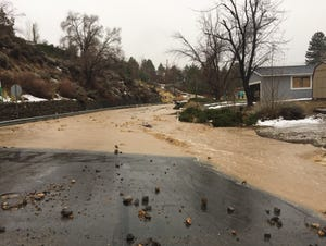 Storm water from the Steamboat Ditch floods Sagittarius Drive in southwest Reno.