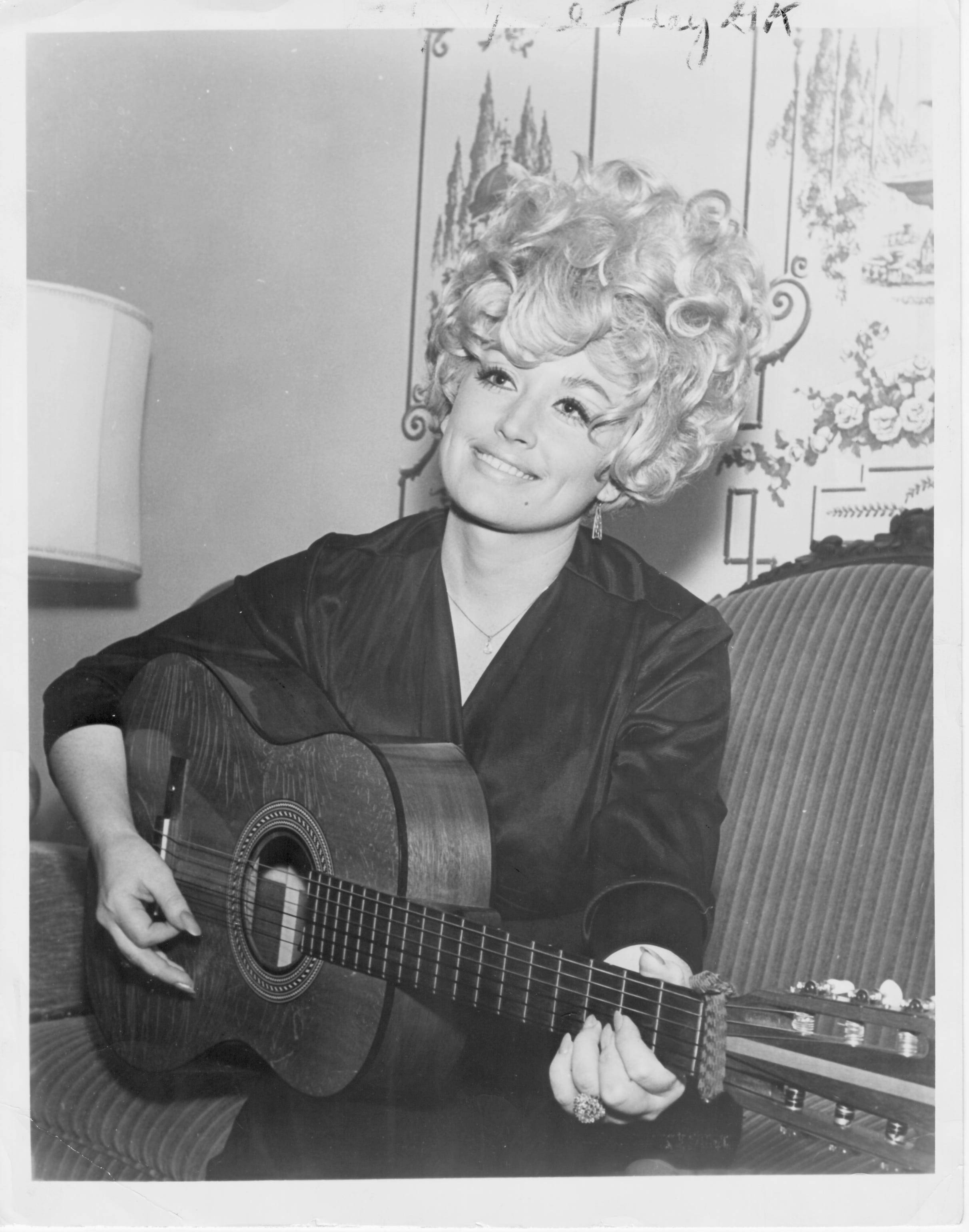 Dolly Parton, seen in 1970, says her uncle taught her the chords on the guitar.