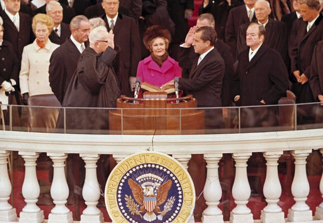 Richard M. Nixon, right, is sworn in as the 37th president of the United States administered by Chief Justice Earl Warren, left, during inaugural ceremonies in front of the Capitol in Washington, D.C., Jan. 20, 1969.  Shown behind Warren is former President Lyndon B. Johnson.