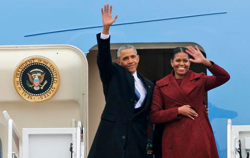Former President Barack Obama and his wife Michelle wave to the crowd as they board an Air Force jet to depart Andrews Air Force base in Andrews Air Force Base, Md., Friday, Jan. 20, 2017.