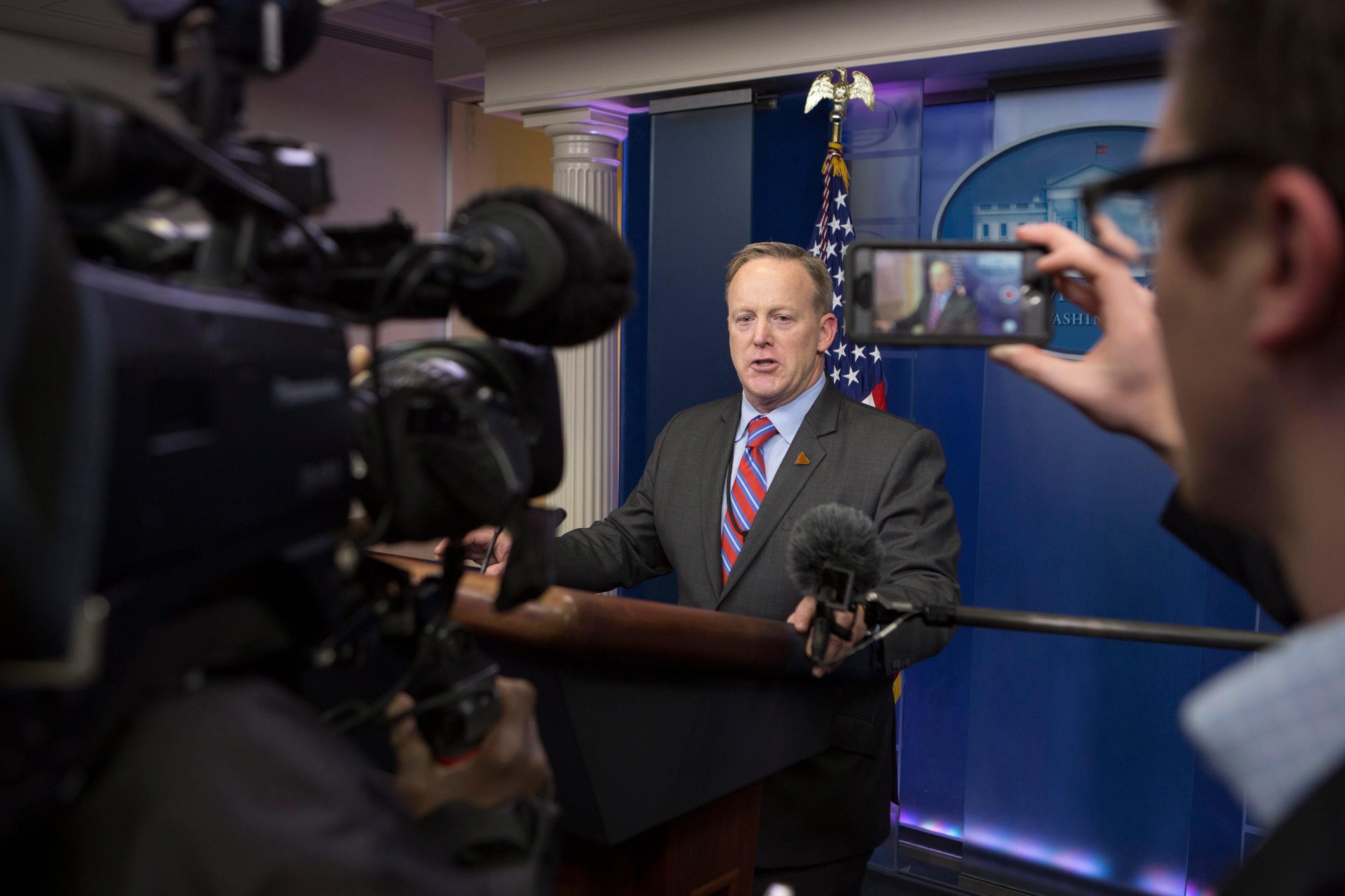On second day, White House press secretary strikes combative tone