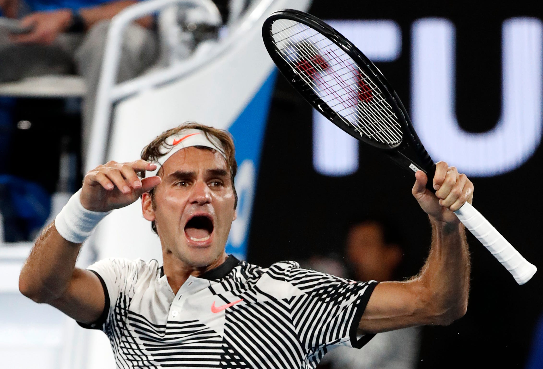 The Latest Federer's tennis better than his singing