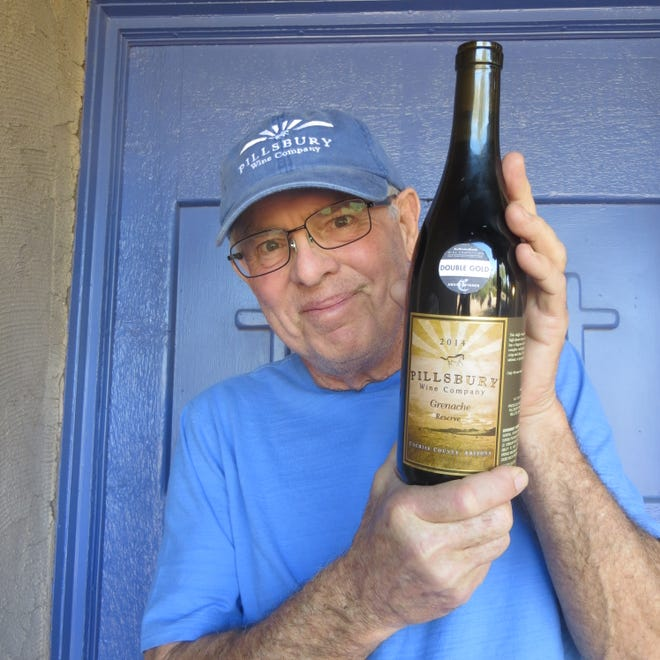 Sam Pillsbury, owner of Pillsbury Wine Company, poses with the Grenache that won a Double Gold in the San Francisco Chronicle Wine Competition.