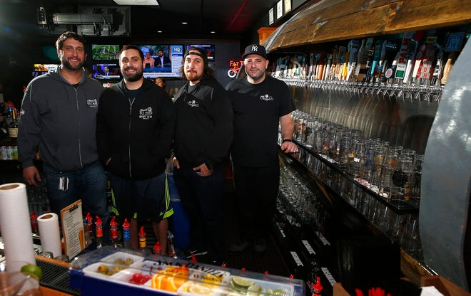 Shown at their current Brielle Ale House Sports Bar and Grille, this crew will soon be opening a new location in Toms River, their third along with a location in Asbury Park. They are (l-r): Mike Solimando and brothers Matthew, Christopher and Frank Gullace.