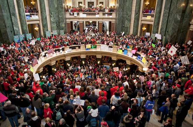 Thousands pack the state Capital in Madison in February 2011 to protest Gov. Scott Walker's Act 10, which placed severe limits on public unions.