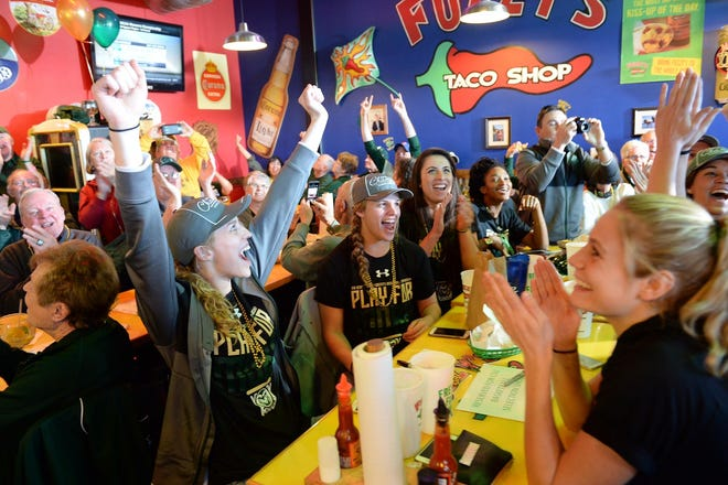 The Colorado State University women's basketball team celebrates at the 2016 NCAA tournament selection show watch party at Fuzzy's Taco Shop on West Elizabeth Street in Fort Collins. Fuzzy's Harmony Road shop scored excellent on its most recent public health inspection.