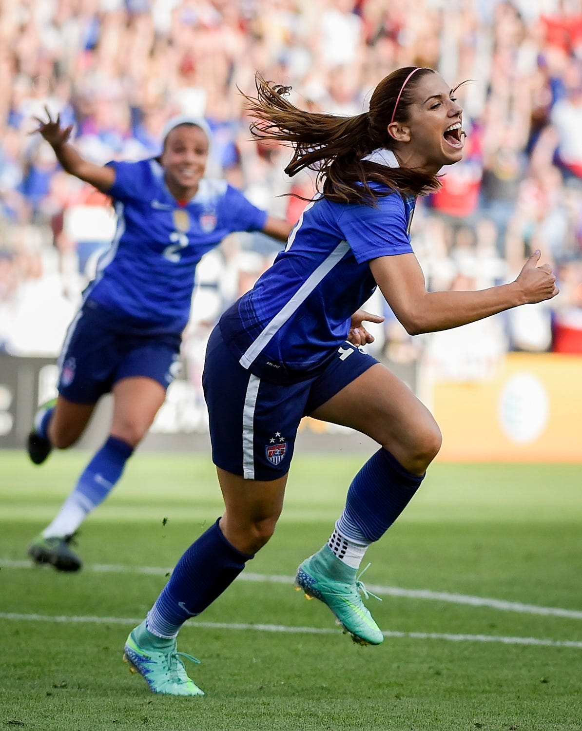 USA's Alex Morgan celebrates after scoring the game