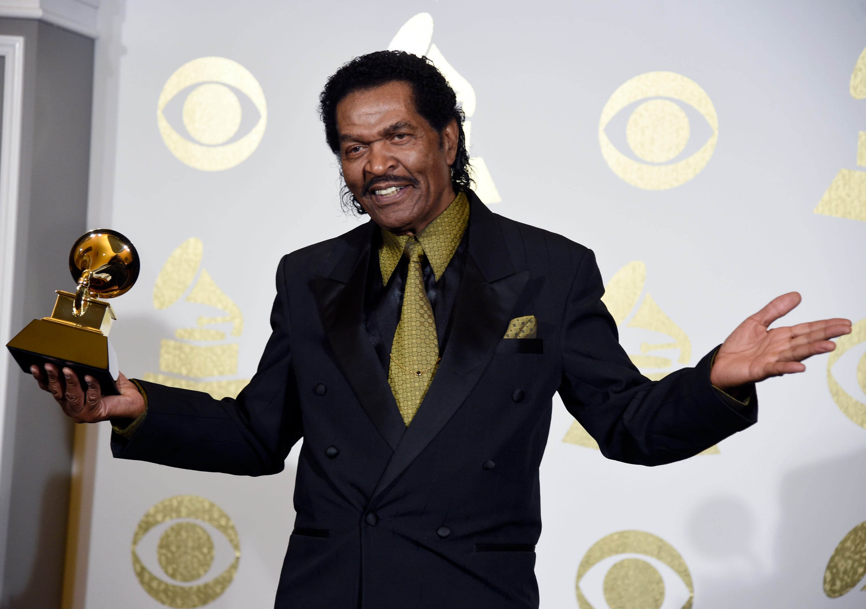 """Bobby Rush poses in the press room with his Grammy for Best Traditional Blues Album for """"Porcupine Meat"""" at the 59th annual Grammy Awards at the Staples Center Sunday in Los Angeles."""