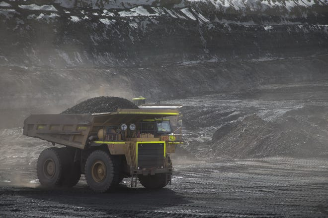 A large dump truck carries coal through the Kayenta Mine in Black Mesa, Ariz., on Feb. 4, 2017. The mine ships 240 rail cars of coal to the Navajo Generating Station every day.