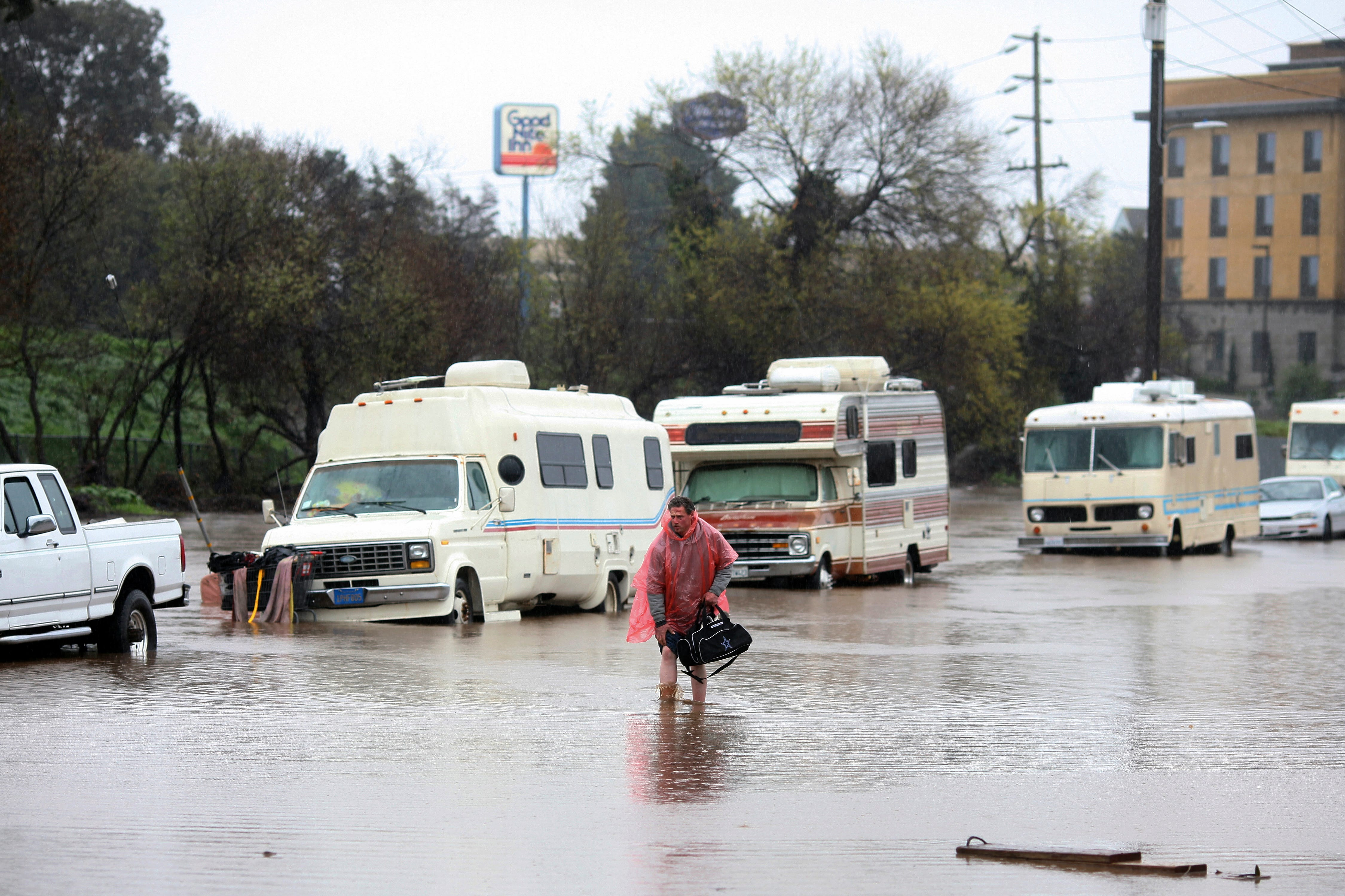 In San Jose, dramatic rescues as hundreds flee rising floodwaters