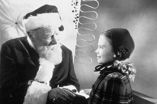 "Edmund Gwenn (left, with a young Natalie Wood), plays Kringle in the 1947 classic ""Miracle on 34th Street."""
