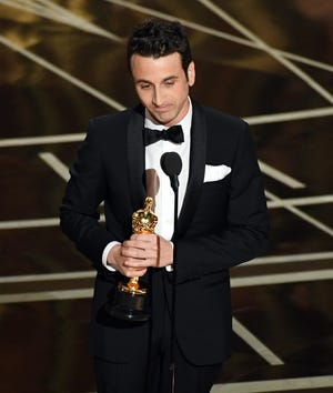 """Composer Justin Hurwitz accepts the award for best original score for """"La La Land"""" onstage during the 89th Annual Academy Awards at Hollywood & Highland Center on Feb. 26, 2017 in Hollywood. The Nicolet High School graduate also won an Oscar for original song, for the movie's """"City of Stars."""""""