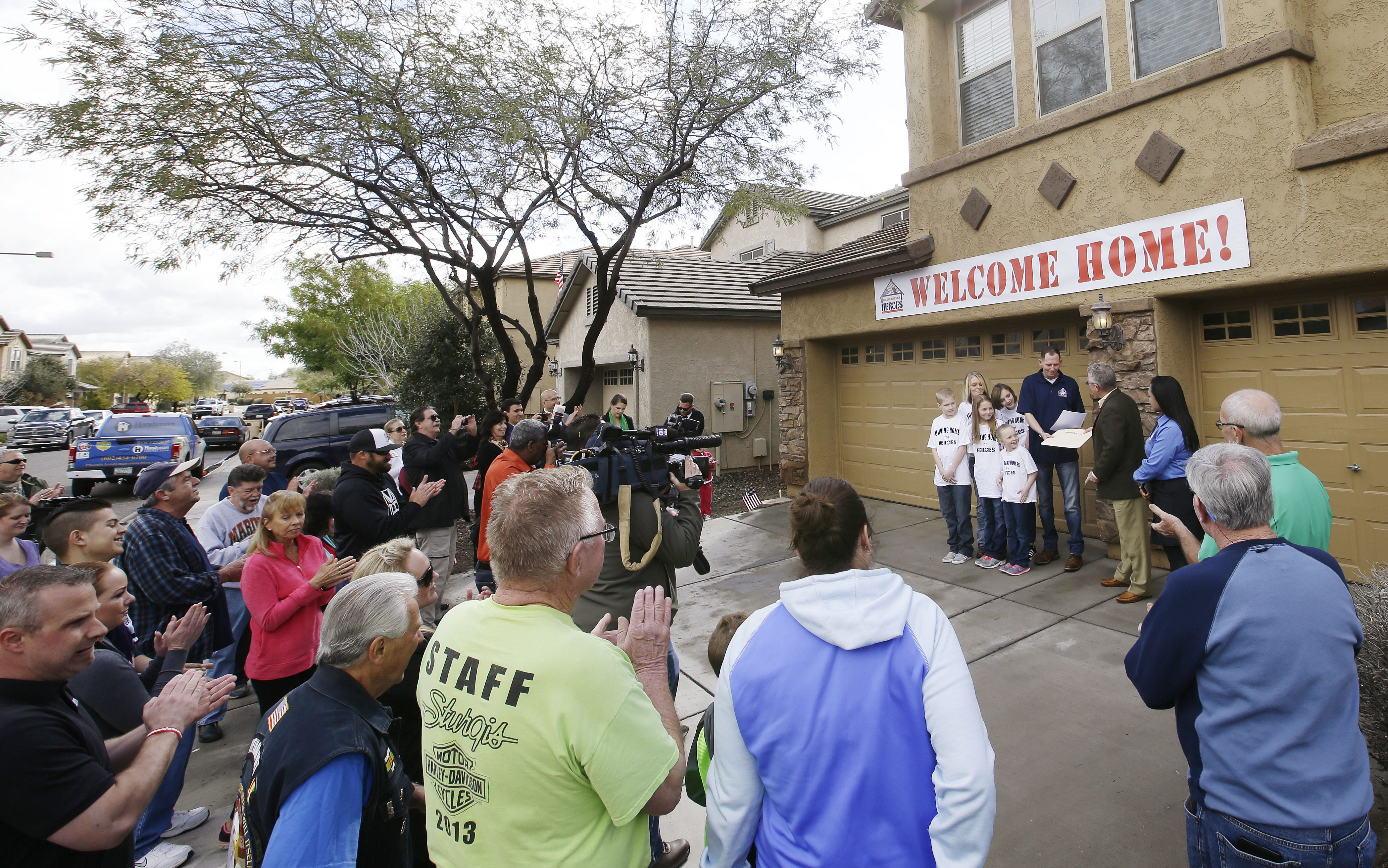 Home at last: Gift brings tears, joy to wounded veteran