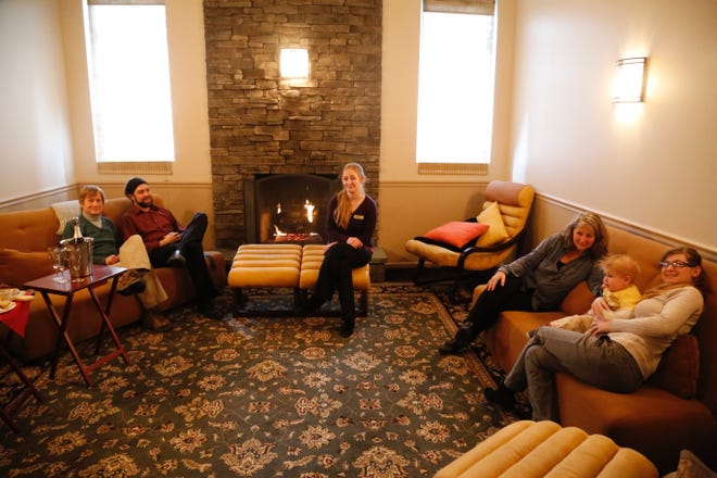 Family members who run La Tourelle relax inside one of August Moon Spa's pre and post-spa rooms. (Left to right) Scott Wiggins, Cameron Ostmeier, Jessica Wiggins, Kash Iraggi-Wiggins, Arson Ostmeier and Phoenix Wiggins.