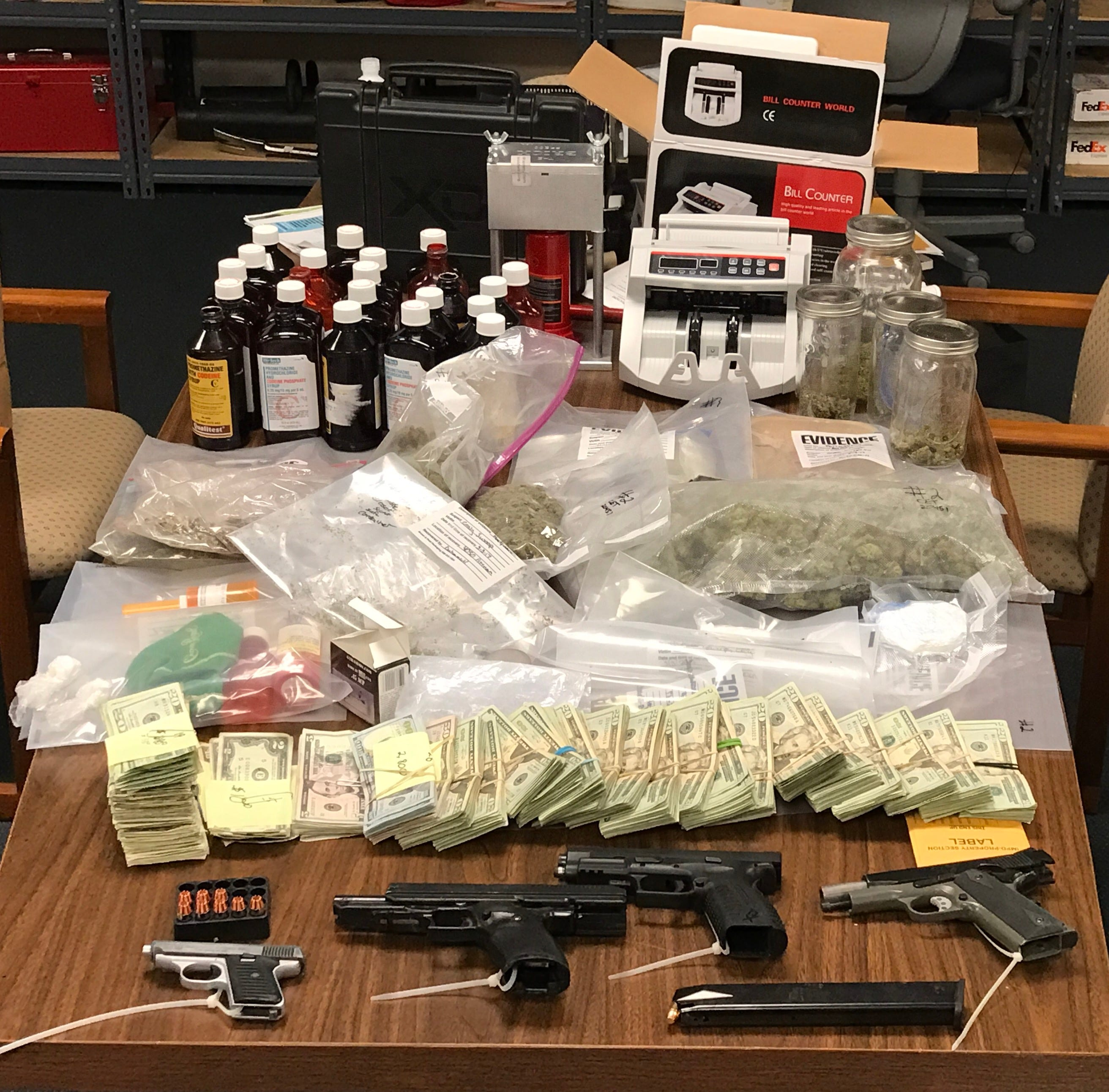 Police find assortment of drugs, handguns in house search