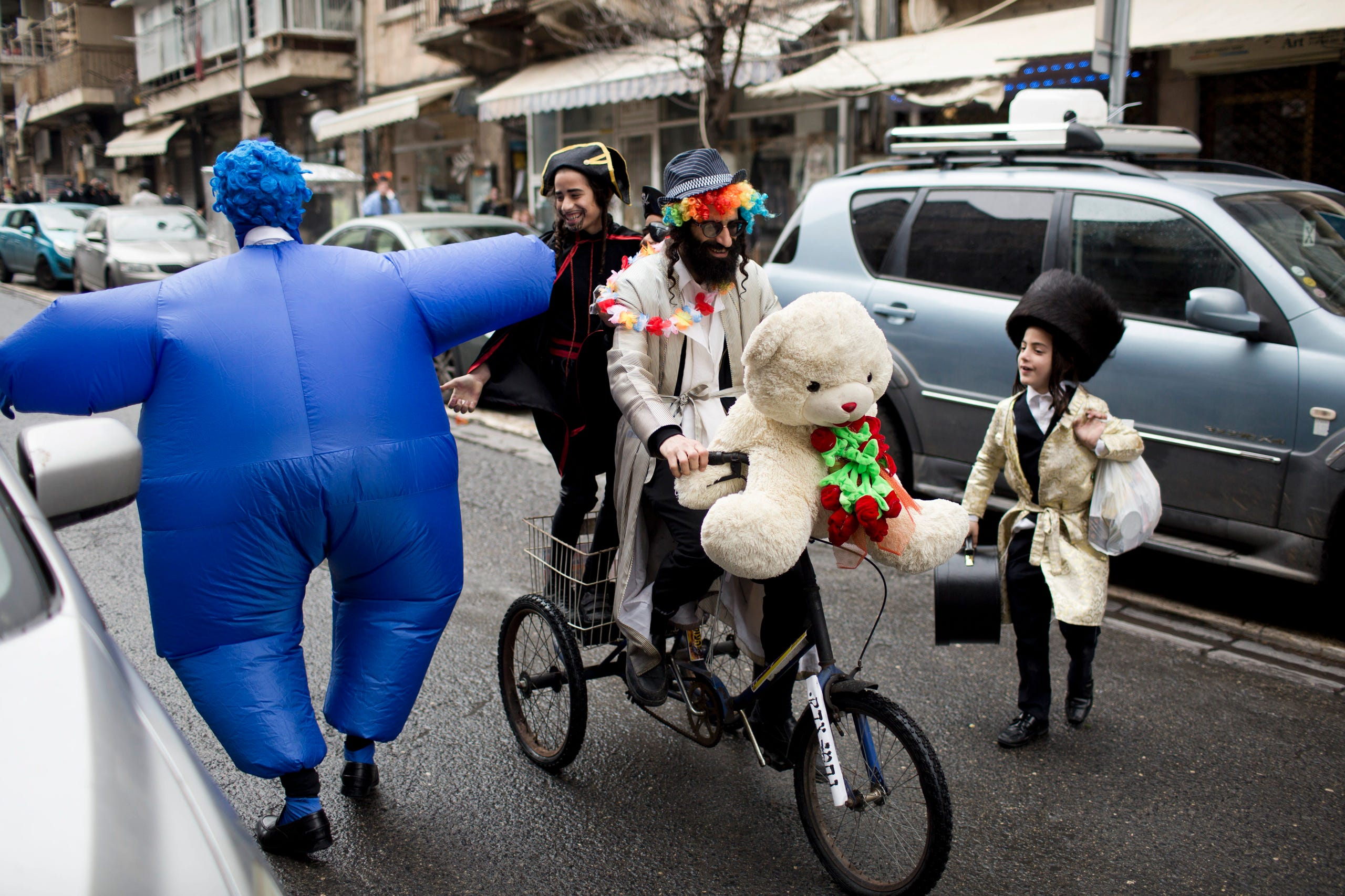 The jewish celebrate purim does what of feast Purim in