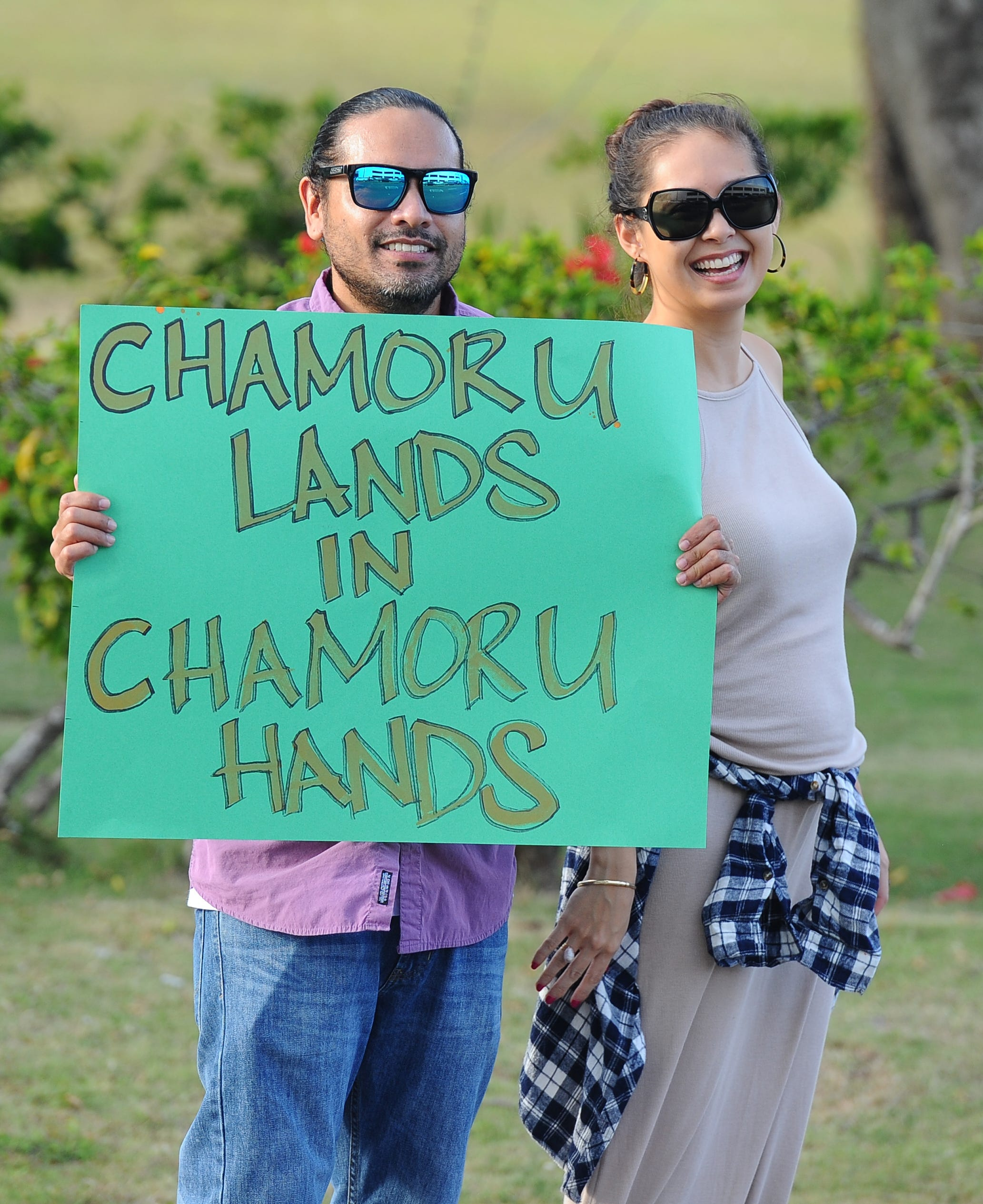 In this March 2016 file photo, activists gather in Tamuning to protest the Chamorro Land Trust Commission's leasing of land to non-Chamorros for commercial use. The U.S. Department of Justice has determined the entire Land Trust program illegally discriminates based on race and wants to enter into a consent decree with the government of Guam.