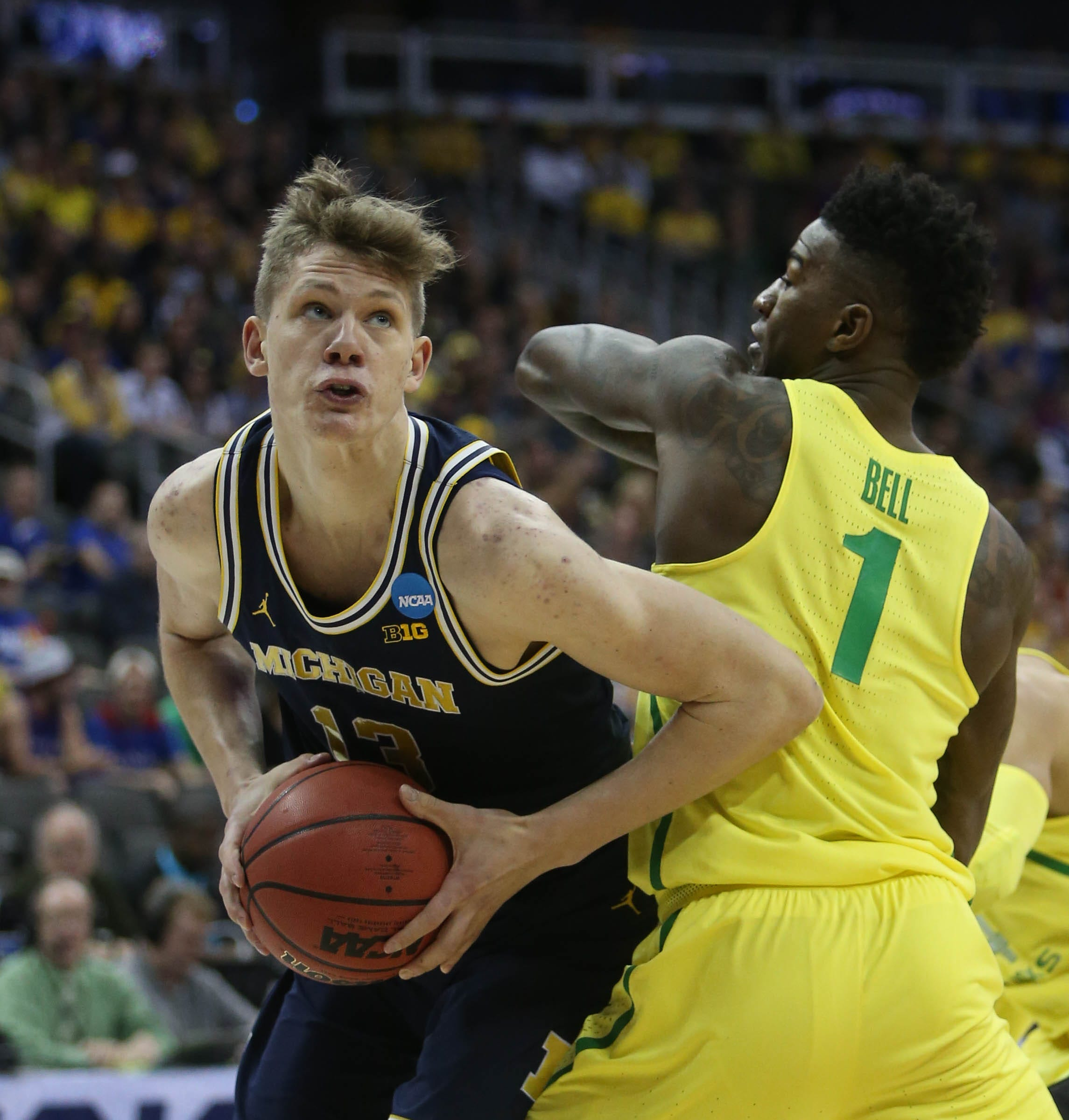 Michigan's small miscues mount, hurt just enough to end the magic