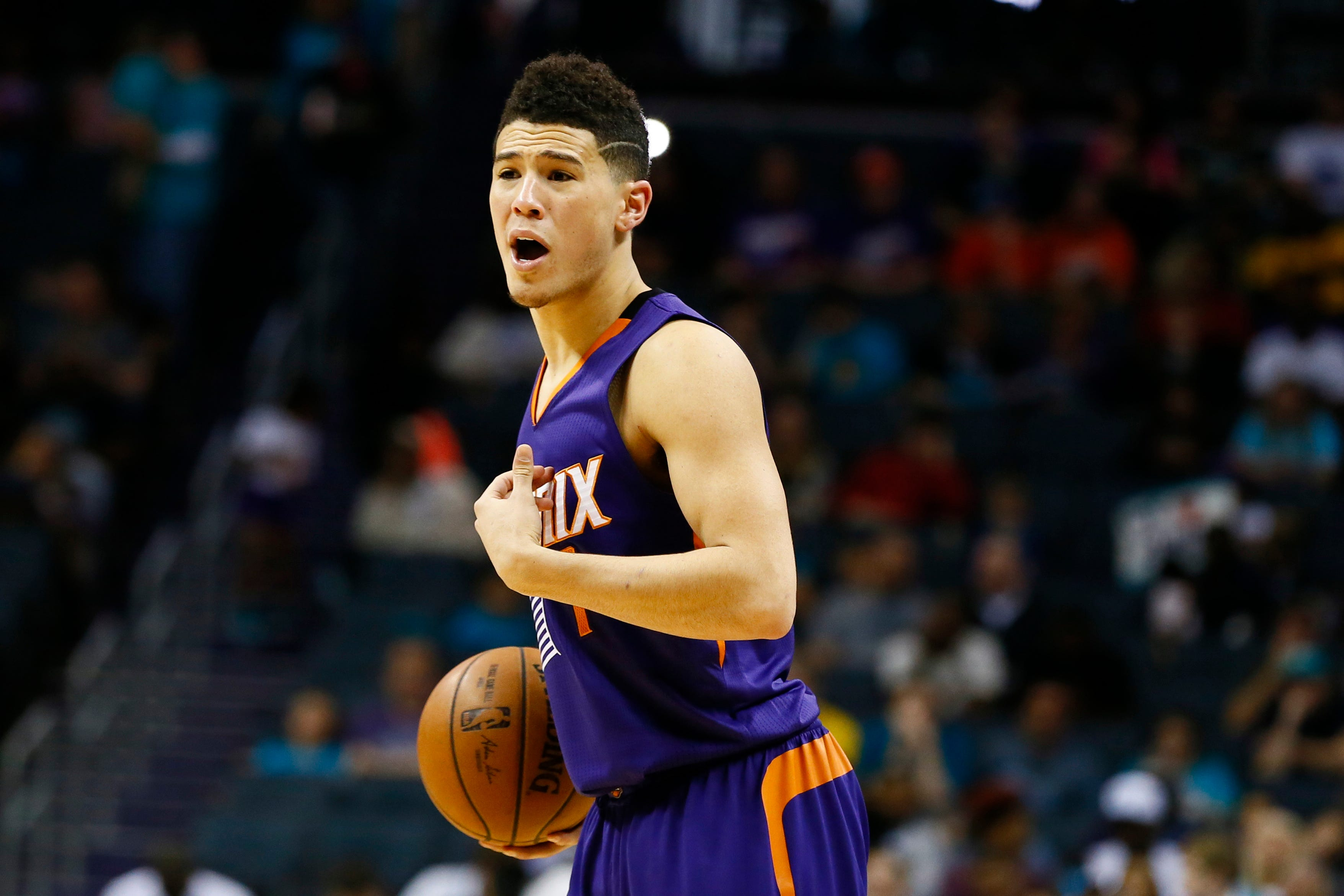 Suns' Devin Booker banged up, takes night off in Atlanta