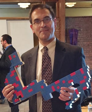 Kevin Deegan-Krause, a political science professor at Wayne State University, has joined an effort to get a proposal on the 2018 ballot that would change the way Michigan redraws the district lines for state and federal elected officials. He uses a Lego-based depiction of the 14th congressional district as an illustration of how gerrymandering is happening in Michigan.