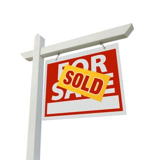 For Sale Real Estate Sign Isolated on a White Background.