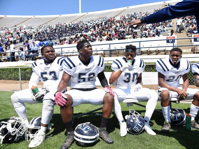 JSU linebacker Darius Woods (52), seen here sitting between Dres Whitlock (left) and Elijah Hill (right), will receive a scholarship and count as part of the 2018 recruiting class.