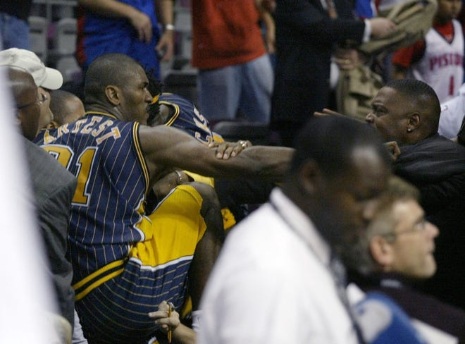 Indiana Pacers forward Ron Artest brawls with Detroit Pistons fans with 45.9 seconds left in the game Friday, Nov. 19, 2004, at the Palace of Auburn Hills. The game was called by the officials.