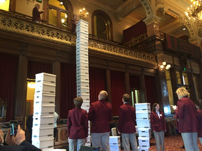 A longstanding tradition in the Iowa Senate has ended with Senate pages being ordered not to stack cardboard boxes that are used to haul lawmakers' paperwork home. This photo shows Senate pages stacking boxes at the end of the 2016 Iowa Legislature's session.