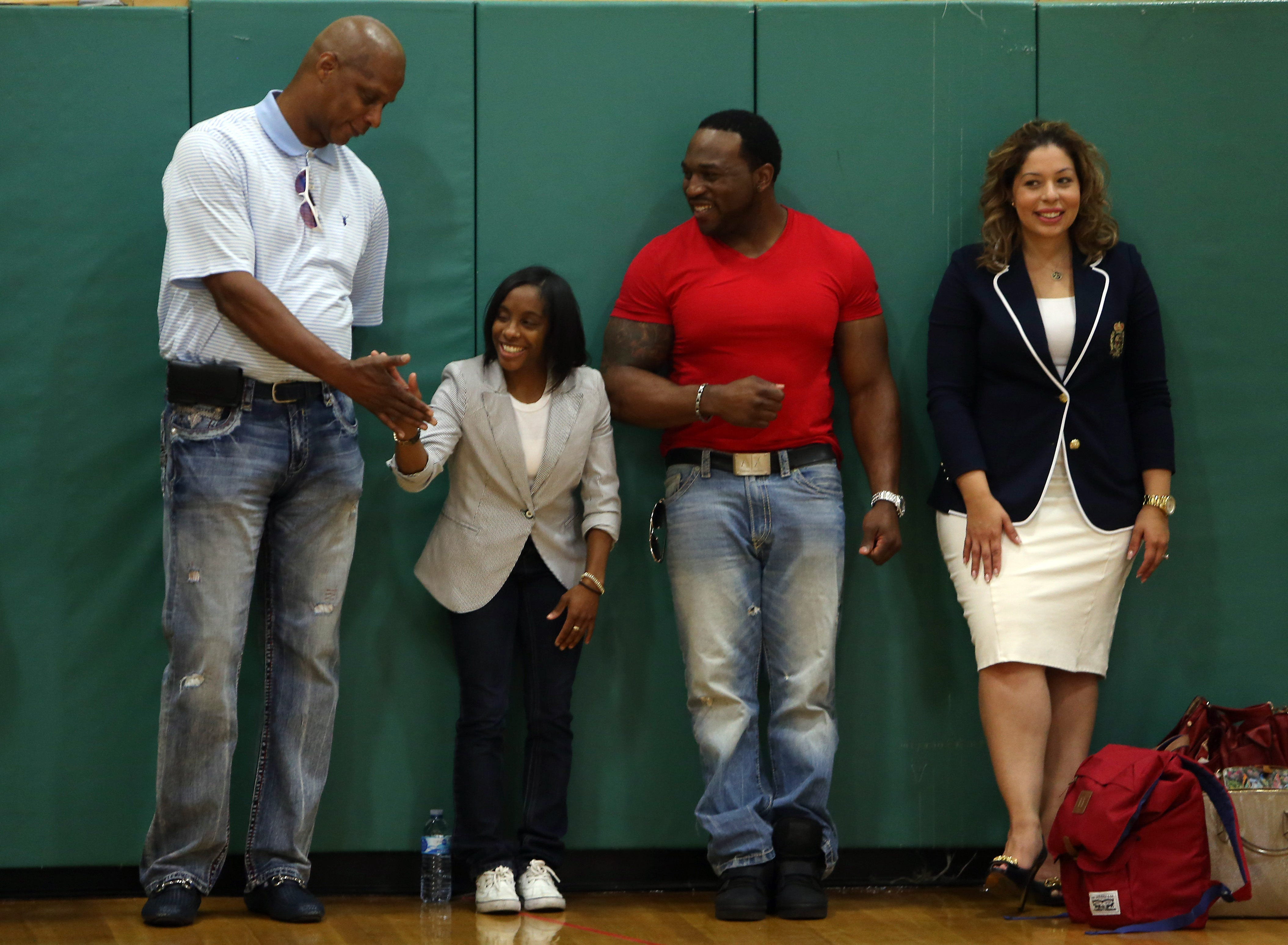 "College basketball star 4' 6"" Tiffara Steward get a high-five from former Major League Baseball right fielder Darryl Strawberry during the Rockaway Township Substance Abuse Alliance's annual Celebrity Day at Copeland Middle School. June 7, 2016, Rockaway, NJ"